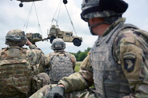 U.S. Army Soldiers from the 2nd Brigade Combat Team, 101st Airborne Division (Air Assault) watch as a CH-47 Chinook flown by Soldiers from the 101st Combat Aviation Brigade, 101st Airborne, sling loads the Tactical Control Node-Light at Fort Campbell, KY, Jun. 15, 2017. The training was part of 2BCT's preparation for the upcoming Network Integration Exercise at Fort Bliss where they will be the first light BCT to participate. (Sgt. Bradford Alex)