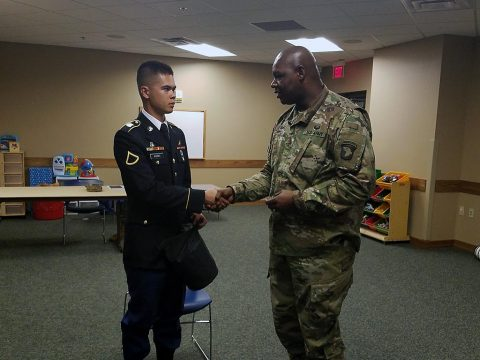 Pfc. Boaz Koski (left), a chaplain assistant with the 101st Special Troops Battalion, 101st Airborne Division (Air Assault), 101st Abn. Div., receives a coin from Master Sgt. Fredrick Murphy (right), the chaplain assistant noncommissioned officer in charge for the 101st Abn. Div., May 31, 2017, after winning the 101st Abn. Div. Chaplain Assistant Soldier of the Quarter board. (Courtesy Photo)