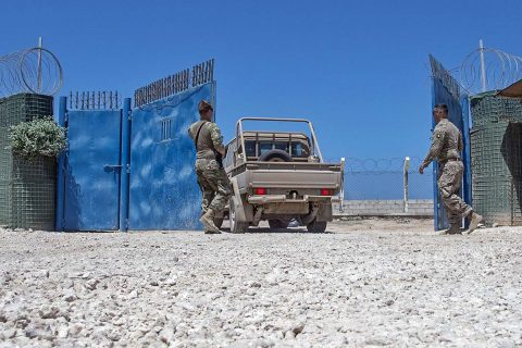 U.S. Army Spc. Tyler Curtis and Spc. Blaine Grubb allow a Somali National Army (SNA) vehicle through the gate at a training site in Mogadishu, Somalia, on May 23, 2017, during a logistics course with the 101st Airborne Division from Fort Campbell, KY. These U.S. Soldiers, who belong to the 101st AD's 1st Brigade, 1st Battalion, Delta Company, 3rd Platoon, were tasked to secure the training site during a logistics training course for the SNA. (U.S. Air National Guard photo by Tech. Sgt. Joe Harwood)