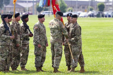 Col. Joseph McCallion, commander of 108th Air Defense Artillery Brigade from Fort Bragg, North Carolina, passes the battalion colors to Lt. Col. Ryan L. Schrock, incoming commander for the 2nd Battalion, 44th ADA Regiment, assigned to the 108th ADA Bde., and attached to the 101st Airborne Division (Air Assault) Sustainment Bde., 101st Abn. Div., during the battalion's change of command ceremony, June 21, 2017, at the division parade field on Fort Campbell, Kentucky. (Neysa Canfield/101st SBDE Public Affairs)