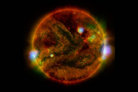 Flaring, active regions of our sun are highlighted in this image combining observations from several telescopes. (NASA/JPL-Caltech/SAO/NOAO)