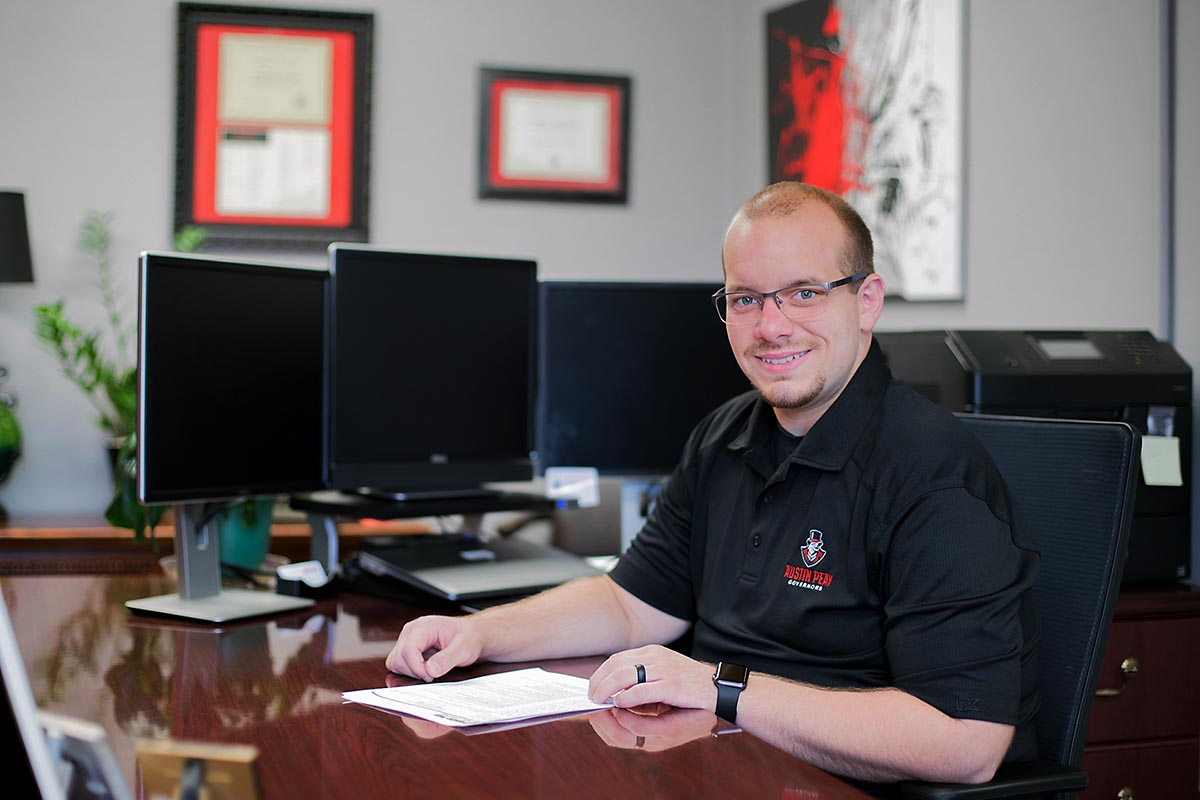 austin peay alumnus, staff member button enrolls in doctorate