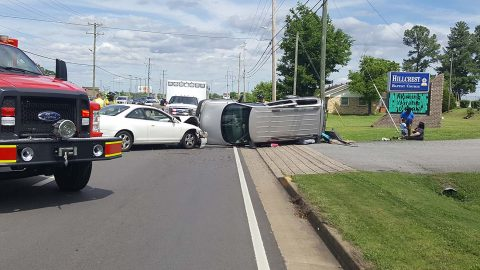 Pontiac Minivan crashes into a Honda Accord and flips over. (Officer Myers, CPD)