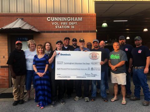 Cunningham Volunteer Fire Department receives check for $8,397.73 from Domino's on Highway 48 owner Antonio Murgas.