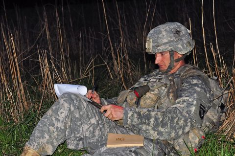 Sgt. Michael Smith, a senior transmission systems operator/maintainer with 58th Signal Company, 101st Special Troops Battalion, 101st Airborne Division (Air Assault) Sustainment Brigade, 101st Abn. Div., plots his coordinates, March 30, 2017, during the nigh land navigation portion of the 101st Abn. Div. (Staff Sgt. Todd L. Pouliot/40th Public Affairs Detachment)