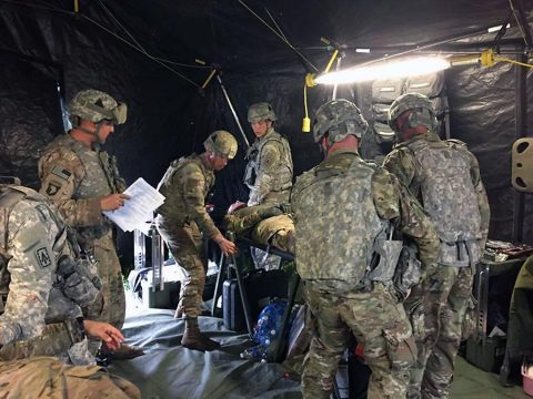 Medics with HHB, 2nd Bn., 44th ADA Regt. conduct training to guarantee all medics are efficient in performing casualty care May 15, 2017, at Range 44A on Fort Campbell, KY. (U.S. Army photo by 1LT Christian R. Cristurean)