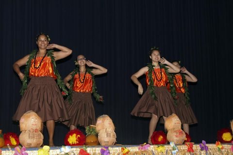 Dancers from the Hui Hawaii O Tenesi Hawaiian Civic Club Dance Group perform a traditional Hawaiian dance, May 31, 2017, at Wilson Theater, Fort Campbell, Kentucky. The performance was part of the Asian American Pacific Islander Heritage month observance hosted by the 101st Airborne Division (Air Assault) Sustainment Brigade, 101st Abn. Div. (Sgt. Neysa Canfield/ 101st SBDE Public Affairs Office)