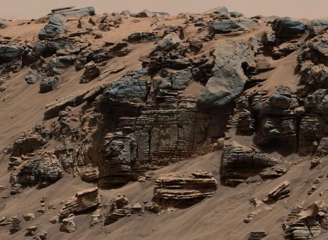 This evenly layered rock imaged in 2014 by the Mastcam on NASA's Curiosity Mars rover shows a pattern typical of a lake-floor sedimentary deposit near where flowing water entered a lake. Shallow and deep parts of an ancient Martian lake left different clues in mudstone formed from lakebed deposits. (NASA/JPL-Caltech/MSSS)