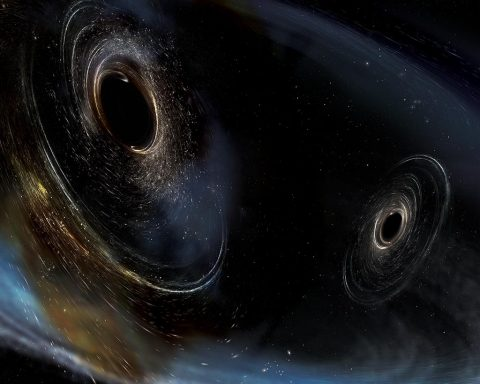 This artist illustration shows two black holes (black spheres) of nearly equal mass as they spiral together and merge. (NASA)