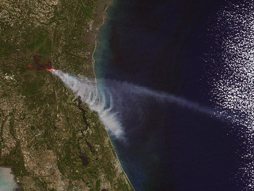 Brown carbon particles produced by wildfires such as the ones that have scorched parts of Georgia and Florida this year are more likely than previously thought to travel to the upper levels of the atmosphere and impact climate. (NASA image courtesy Jeff Schmaltz LANCE/EOSDIS MODIS Rapid Response Team, GSFC)