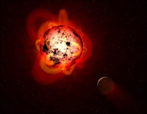 This illustration shows a red dwarf star orbited by a hypothetical exoplanet. (NASA/ESA/G. Bacon (STScI))