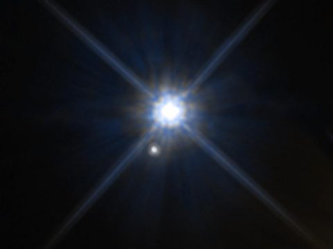 Looks can be deceiving. In this Hubble Space Telescope image, the white dwarf star Stein 2051B and the smaller star below it appear to be close neighbors. The stars, however, reside far away from each other. Stein 2051B is 17 light-years from Earth; the other star is about 5,000 light-years away. Stein 2051B is named for its discoverer, Dutch Roman Catholic priest and astronomer Johan Stein. (NASA, ESA, and K. Sahu (STScI))