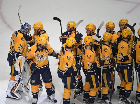 Nashville Predators goalie Pekka Rinne (35) is congratulated by teammates after beating the Pittsburgh Penguins 4-1 in game four of the 2017 Stanley Cup Final at Bridgestone Arena. (Scott Rovak-USA TODAY Sports)