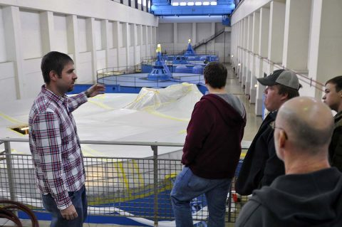 U.S. Army Corps of Engineer, Nashville District employees Jamie Holt, a power project specialist at the Lake Barkley power plant shows students and faculty from University of Tennessee at Martin Hydrology and Hydraulics class maintenance being performed on a generator at the Lake Barkley power plant. (Mark Rankin, USACE)