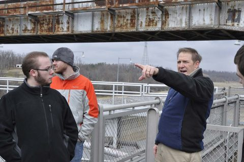 U.S. Army Corps of Engineer, Nashville District employee Michael Looney, Natural Resource Program Manager at the Lake Barkley Resource Center talks with students and faculty from University of Tennessee at Martin Hydrology and Hydraulics class about lock operations during a tour of the Lake Barkley Barkley lock and dam. (Mark Rankin, USACE)