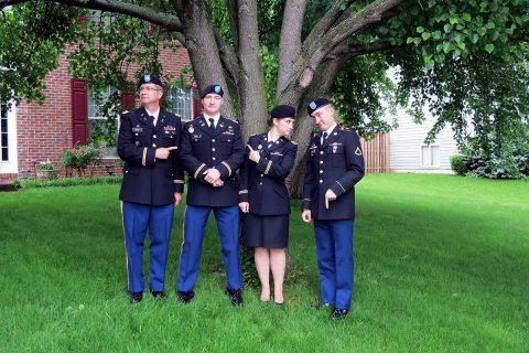 (From left to right) Retired Maj. Thomas Mehr, 1st Lt. James Mehr, 2nd Lt. Sarah Mehr, and Pfc. Steven Mehr, pose for a family photograph following Sarah's commissioning ceremony May 18, 2013. (Courtesy photo)