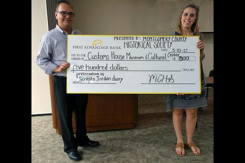Customs House Curator of Collections Kali Mason receives a $500.00 check from Jeff Harris, treasurer of the Montgomery County Historical Society, to help pay for restoration of the journal kept by New Providence resident Serepta Jordan from 1857 to 1864.