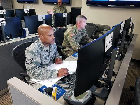 Tech. Sgt. Anthony Cherry, left, and Staff Sgt. Philip Wallace manage personnel actions, such as accountability and availability of National Guard personnel at the Emergency Operations Center of the Tennessee National Guard Joint Force Headquarters in Nashville June 15th. (Master Sgt. Robin Brown.)