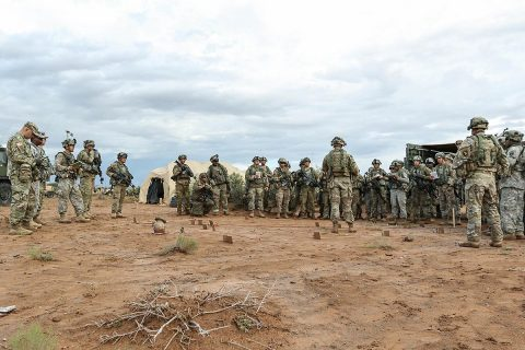 Soldiers with 1st Battalion, 320th Field Artillery Regiment, 2nd Brigade Combat Team, 101st Airborne Division, conduct a three-dimensional map briefing prior to a command post movement, July 23, McGregor Range Complex, New Mexico. Observer controllers oversee activities during Network Integration Evaluation. (Sgt. Maricris C. McLane)