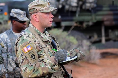 Maj. Josh Howard, senior fires observer controller with Training and Evaluation Division, Joint Modernization Command takes note while 1st Battalion, 320th Field Artillery Regiment, 2nd Brigade Combat Team, 101st Airborne Division, conduct a three-dimensional map briefing prior to a command post movement, July 23, McGregor Range Complex, New Mexico. Observer controllers oversee activities during Network Integration Evaluation. (Sgt. Maricris C. McLane)