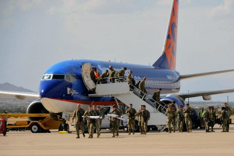 "Soldiers with 2nd Brigade Combat Team, 101st Airborne Division from Fort Campbell, Kentucky, disembark the plane during their arrival for the Network Integration Exercise 17.2, here, July 5. The ""Strike"" Brigade with 101st ABN DIV is the first rotational brigade to conduct NIE here. (Capt. Earl Wilson)"