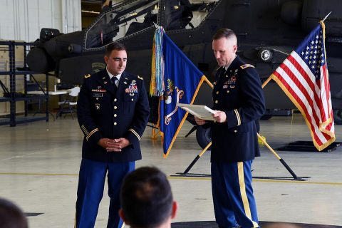 Col. Bernard Harrington, the commander of the 82nd Combat Aviation Brigade, presents an award to Chief Warrant Officer 4 James Morrow, a flight instructor from Fort Rucker, June 30, 2017 at Fort Campbell, KY. (Sgt. Marcus Floyd, 101st Combat Aviation Brigade)
