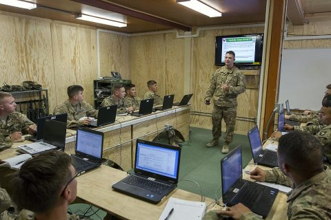 Soldiers discuss a scenario based question during the Basic Leaders Course on Bagram Airfield, Afghanistan. This is the first time the course has been held in Afghanistan. (Sgt. 1st Class Eliodoro Molina, U.S. Forces Afghanistan)