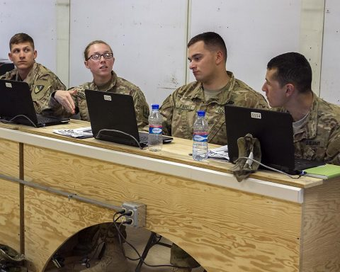 Soldiers discuss their experiences during the Basic Leaders Course on Bagram Airfield, Afghanistan. This is the first time the course has been held in Afghanistan. (Sgt. 1st Class Eliodoro Molina, U.S. Forces Afghanistan)