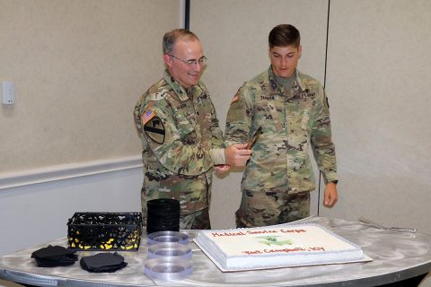 Col. Anthony L. McQueen, BACH commander, and 2nd Lt. Gregory Tarman, Jr., 626th Brigade Support Battalion, 3rd Brigade Combat Team, cut the Medical Service Corps' 100th Anniversary cake at Fort Campbell's Cole Park Commons, June 29th, as the Medical Service Corps officers at Fort Campbell gathered to celebrate the anniversary and their Corps' service in the Army.