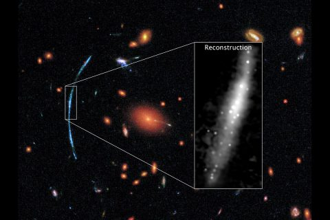 In this Hubble photograph of a distant galaxy cluster, a spotty blue arc stands out against a background of red galaxies. That arc is actually three separate images of the same background galaxy. The background galaxy has been gravitationally lensed, its light magnified and distorted by the intervening galaxy cluster. On the right: How the galaxy would look to Hubble without distortions. (NASA, ESA, and T. Johnson (University of Michigan)