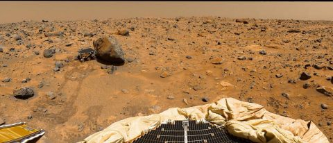 """This portion of a classic 1997 panorama from the IMP camera on the mast of NASA's Mars Pathfinder lander includes """"Twin Peaks"""" on the horizon, and the Sojourner rover next to a rock called """"Yogi."""" (NASA/JPL)"""
