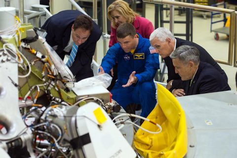 Vice President Mike Pence, second from right, looks at the Orion capsule that will fly on the first integrated flight with the Space Launch System rocket in 2019, during a tour of the Kennedy Space Center's (KSC) Operations and Checkout Building on Thursday, July 6, 2017. The Vice President was joined by NASA Acting Administrator Robert Lightfoot, left; Kennedy Space Center Deputy Director Janet Petro, second from left; NASA astronaut Reid Wiseman, center; and Kennedy Space Center Director Robert Cabana, right. (NASA/Aubrey Gemignani)