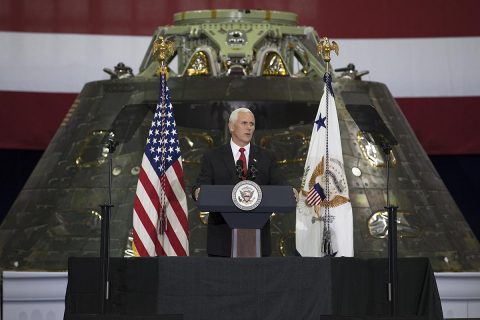 Vice President Mike Pence speaks before an audience of NASA leaders, U.S. and Florida government officials, and employees inside the Vehicle Assembly Building at NASA's Kennedy Space Center in Florida. Pence thanked employees for advancing American leadership in space. Behind the podium is the Orion spacecraft flown on Exploration Flight test-1 in 2014. (NASA/Kim Shiflett)