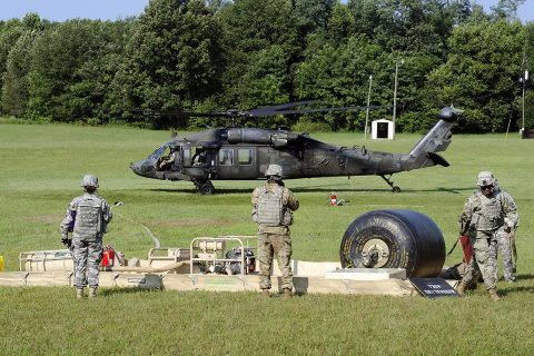 Fuelers from E Company, 6th Battalion, 101st General Support Aviation Battalion, 101st Combat Aviation Brigade, 101st Airborne Division, complete a refueling mission for a UH-60 Black Hawk helicopter Aug. 9 at Fort Campbell, Kentucky. The aviation support mission augmented the unit's team participating in the U.S. Army Forces Command level Philip A. Connelly food service competition. (Leejay Lockhart, Fort Campbell Public Affairs Office)