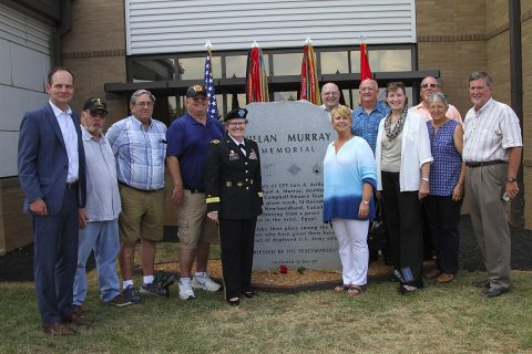 Lt. Gen. Karen Dyson, the Military Deputy to the Assistant Secretary of the Army (Financial Management and Comptroller), poses for a group picture, June 25, 2017, with veterans of the Fort Campbell finance team after the memorial rededication ceremony at the Defense Military Pay Office on Fort Campbell, Kentucky. (Sgt. Neysa Canfield/101st SBDE Public Affairs)
