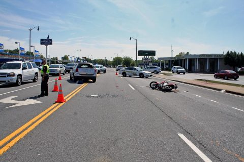 Clarksville Police work a motorcycle accident Sunday afternoon at Riverside Drive and North Second Street. (Bill Van Beber III, CPD)