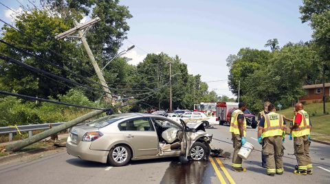 A Nissan Altima left the roadway on Crossland Avenue and stuck a utility pole Thursday afternoon. (Jim Knoll, CPD)