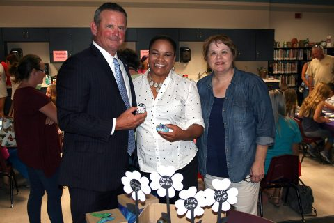 Montgomery County Mayor Jim Durrett, Clarksville Mayor Pro Tem Valerie Guzman, and Rita Arancibia show off some Kindness Rocks at the Public Library.