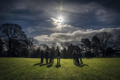 People watch a partial eclipse in Belfast, Northern Ireland, on March 20, 2015. (Robin Cordiner)