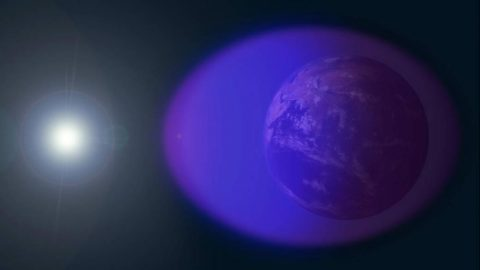 During typical day-night cycles, the ionosphere — shown in purple and not-to-scale in this image — waxes and wanes with the Sun. The total solar eclipse will cut off this region's source of ionizing radiation. (NASA's Goddard Space Flight Center/Duberstein)