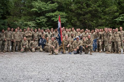 Soldiers with the 2nd Battalion, 506th Infantry Regiment 'Currahee' pose for a group photo following a five-mile ruck around Ft. Campbell, Aug 2. The Battalion honored Richard M. McErlean III for his service to the Currahee Regiment. (Spc. Patrick Kirby, 40th Public Affairs Detachment)