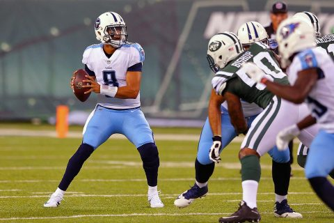 Tennessee Titans quarterback Marcus Mariota (8) drops back to pass against the New York Jets during the first quarter of a preseason game at MetLife Stadium. (Brad Penner-USA TODAY Sports)