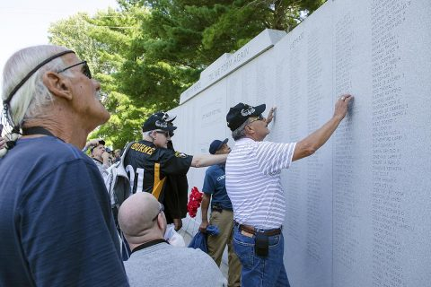 Veterans and their Families who returned to Fort Campbell Sept. 8, 2017, to commemorate the 50th anniversary of the founding of D Company, 3rd Battalion, 187th Infantry Regiment, 3rd Brigade, 101st Airborne Division, visits a wall that includes the names of the Rakkasans that fell in combat during a search and destroy mission in March 1968. These veterans did not find out the fate of the Soldiers evacuated from the battlefield with critical wounds for decades, and the reunion was the first time some of the veterans had seen each other since Vietnam. (Leejay Lockhart)