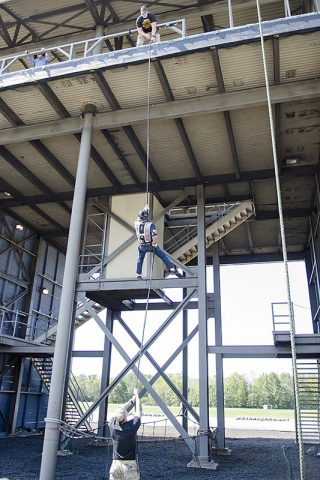 Ray Pfeffer rappels from the tower at The Sabalauski Air Assault School with help from the cadre during a tour of Fort Campbell Sept. 8, 2017. Pfeffer was part of D Company, 3rd Battalion, 187th Infantry Regiment, 3rd Brigade, 101st Airborne Division, the most highly decorated unit for its size in the Vietnam War. (Leejay Lockhart)