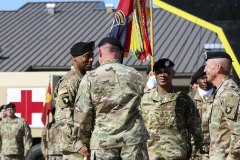 Col. Stanley J. Sliwinski, commander for the 101st Airborne Division (Air Assault) Sustainment Brigade, 101st Abn. Div., hands the brigade colors to Command Sgt. Maj. Anthony B. McAdoo, incoming command sergeant major for the 101st Abn. Div. Sust. Bde., Sept. 7, 2017, during a change of responsibility ceremony on Fort Campbell, Kentucky. (Sgt. Neysa Canfield/101st SBDE Public Affairs)