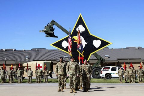 (Center left to right) Command Sgt. Maj. Anthony B. McAdoo, incoming command sergeant major, Col. Stanley J. Sliwinski, commander, and Command Sgt. Maj. Michael J. Perry III, outgoing command sergeant major, all with the 101st Airborne Division (Air Assault) Sustainment Brigade, 101st Abn. Div., face the audience after transfer the responsibility of the brigade from one senior enlisted adviser to the other, Sept. 7, 2017, during a ceremony on Fort Campbell, Kentucky. (Sgt. Neysa Canfield/101st SBDE Public Affairs)