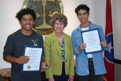 Domingo Mendez and Christian Johnson were commended by Clarksville Mayor Kim McMillan for their quick actions to aid a man who was trapped under a lawn tractor.