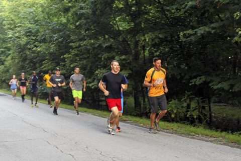 Capt. Josh Joseph (front right), commander for Headquarters and Headquarters Company, 101st Special Troops Battalion, 101st Airborne Division (Air Assault) Sustainment Brigade, 101st Abn. Div., and another member of the Fort Campbell, Kentucky Ten Miler Team, lead a group of runners, Aug. 3, 2017, during practice trail run on Fort Campbell, Kentucky. (Sgt. Neysa Canfield, 101st Sustainment Brigade, 101st Airborne Division (AA) Public Affairs)