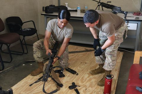 BACH NCO, Staff Sgt. Marie Rubin provides MEDCOM Best Warrior NCO Sgt. 1st Class Christopher Taylor training on the break-down and assembly of weapons to help Taylor prepare for the Army's Best Warrior Competition.  (U.S. Army Photo by Maria Yager)