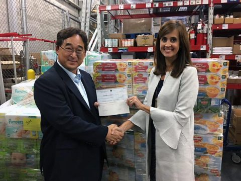 Jay Kim, Vice President of Corporate Strategy for Hankook Tire America Corp. hands Ginna Holleman, CEO of Clarksville United Way a check for $10,000 to be used for towards supplies for the victims of Hurricane Harvey.